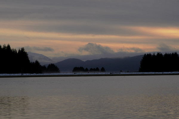 Sunset looking across Lynn Canal at Shelter Island near Juneau, Alaska. Photograph was taken near mid-winter.