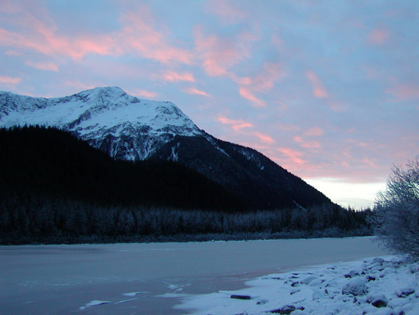 Sunrise at Eagle Glacier Lake. This photograph was taken on winter solstice from just outside a U. S. Forest Service Cabin.