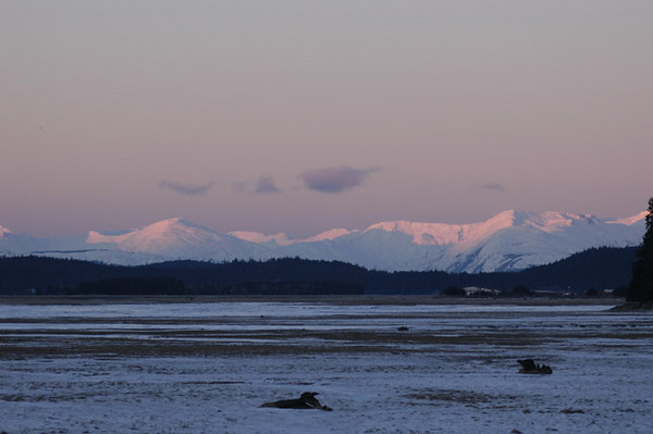 Sunrise across the Mendenhall Flats near the Juneau Airport. This photograph was taken in January, typically the coldest month of the year.