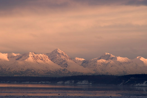 Sunrise looking across Cook Inlet at the Alaska Range near Anchorage, Alaska.