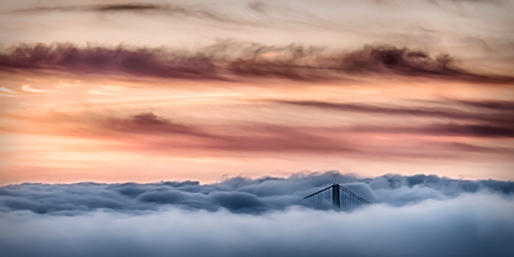 One of the Golden Gate Bridge stansions poking through the fog during sunset.  This image is 12x24 so you can order a panorama version or crop it to 11x14 or 16x20.  I think a canvas wrap would be best.