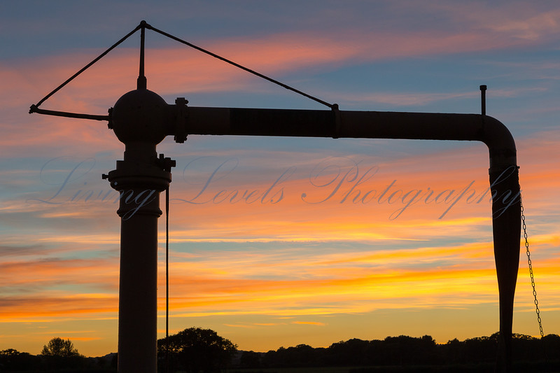 The sun sets behind the water tower at Bisops Lydeard Station on the West Somerset Railway during the 2013 Autumn Steam Gala