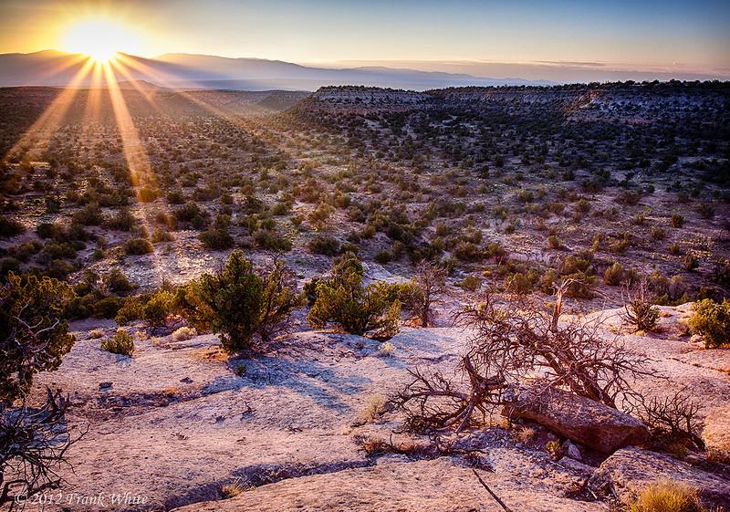 Sunrise over the mountains, west of Santa Fe, near Bandoleer National Monument. 3-shot HDR.
