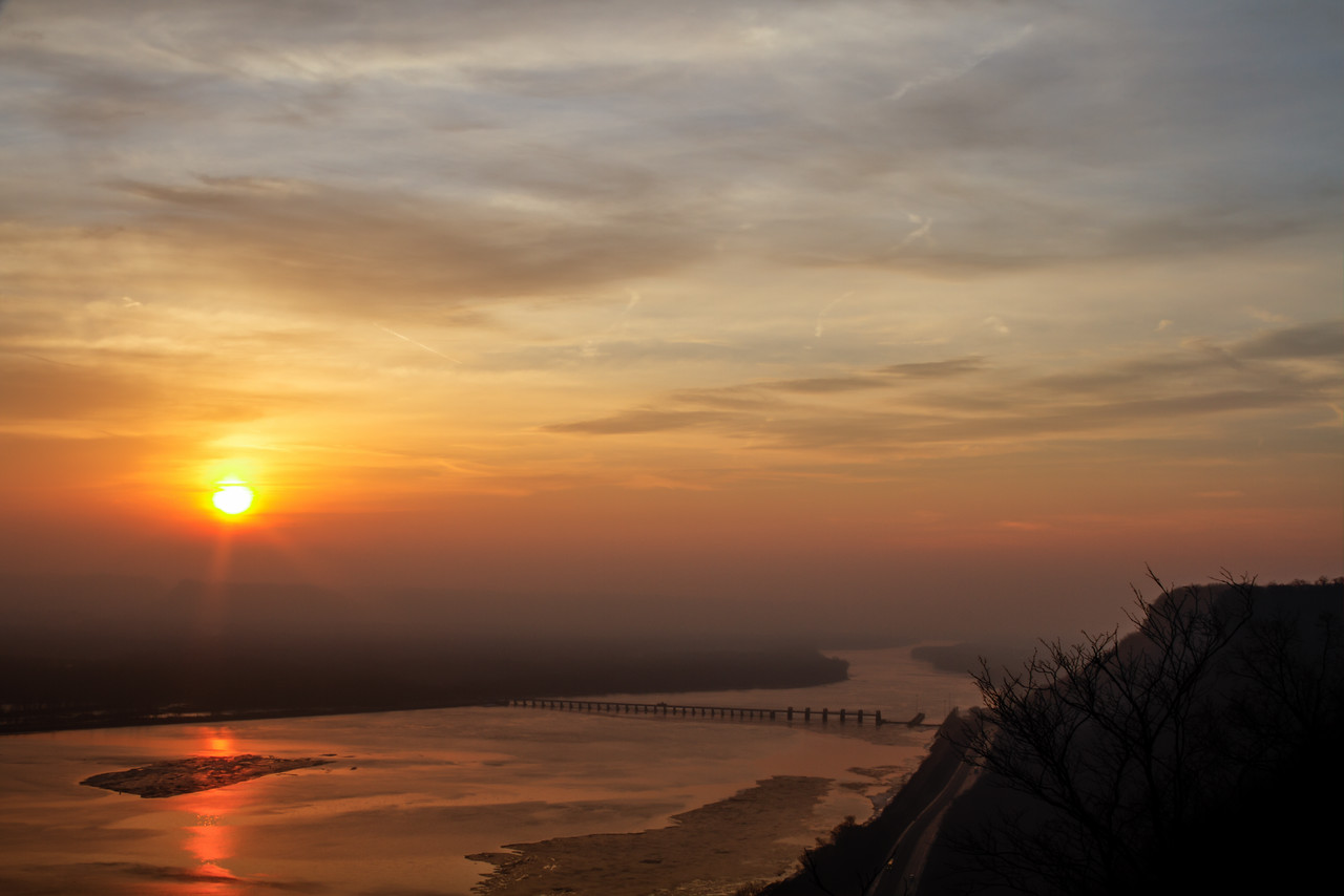 Sunrise over the Mississippi River with Lock and Dam 5 visible.