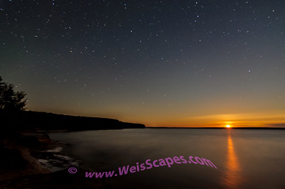 Cold fall Harvest Moonset, at Mosquito Beach, Pictured Rocks National Lakeshore.