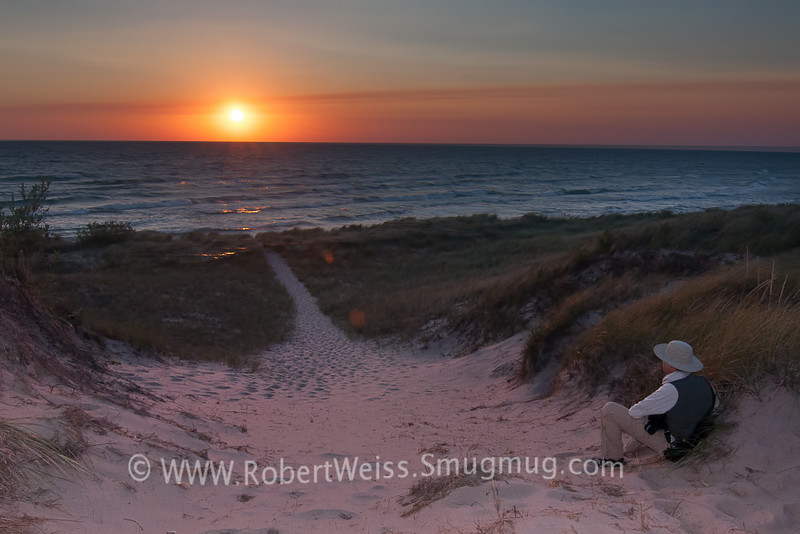 Watching the sun set at the top of a sand dune, Ludington State Park, MI.