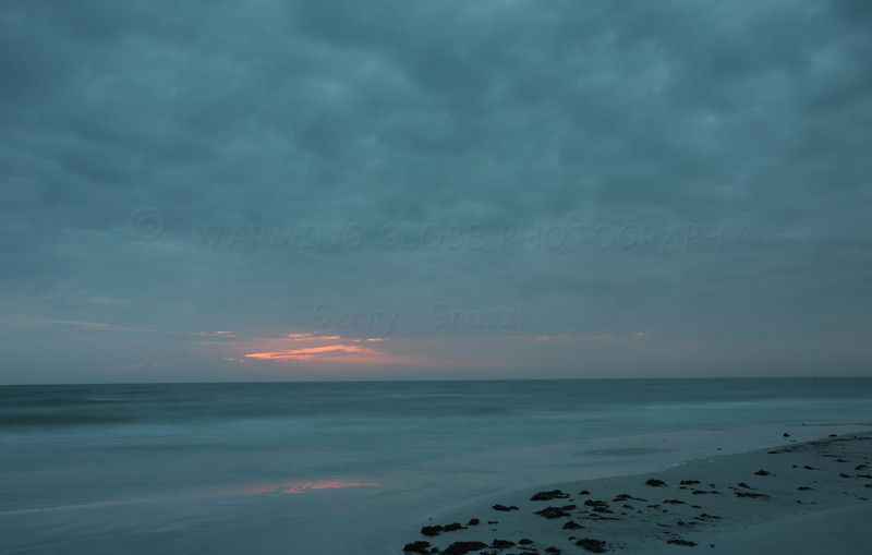 storm coming in, the green of the sea the clouds seem to blend this eve.