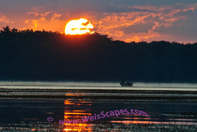 The sun rises over fisherman at Stoney Creek.