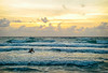 Sunrise surf diver with sailboat on the horizon, Briny Breezes, FL