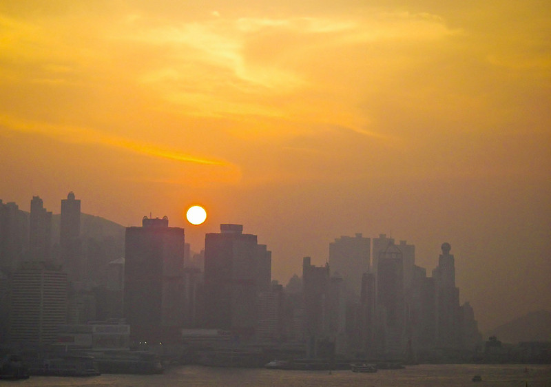 Air pollution makes for great sunset pictures; Hong Kong Island from across the harbor.