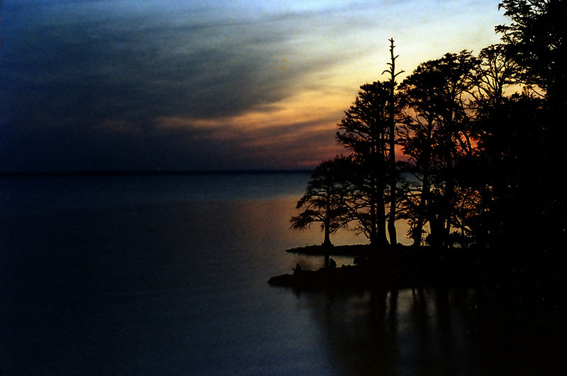 Sundown on the James River in early spring, 1982. I remember we camped here on the Northern Virginia Garden Tour, brought back pizza from a place near William and Mary and that it was freezing outside the tent at sunrise the next day.<br /> <br /> I also remember seeing for the first time how beautiful Crepe Myrtle were and hearing antebellum house slaves referred to as 'servants'.