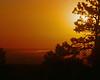 Sunrise from Flasgstaff Mt Park Boulder. Valmont Butte Power plant makes its mark.