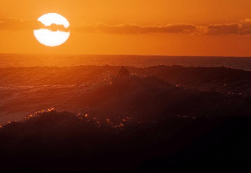 Sunset surfer on Sunset Beach