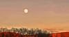 Sunset skyline with moon
