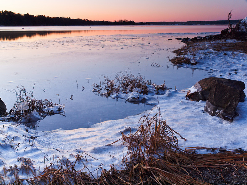 0 degrees F @ Adams Point, Great Bay, Durham NH<br /> Jan 2010.  It's always a challenge to do a sunrise or set without clouds in the sky.  Your attention turns to foreground elements and I'm so glad I found some.  That crusty snow reflects the sky color so well.