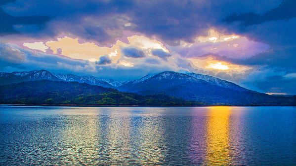 """Whiskeytown Lake glows in a late afternoon spring storm break. A """"posterization"""" technique has been applied to the sky in this image for dramatic effect.This image will print well on any surface, but will be especially striking when printed on canvas."""