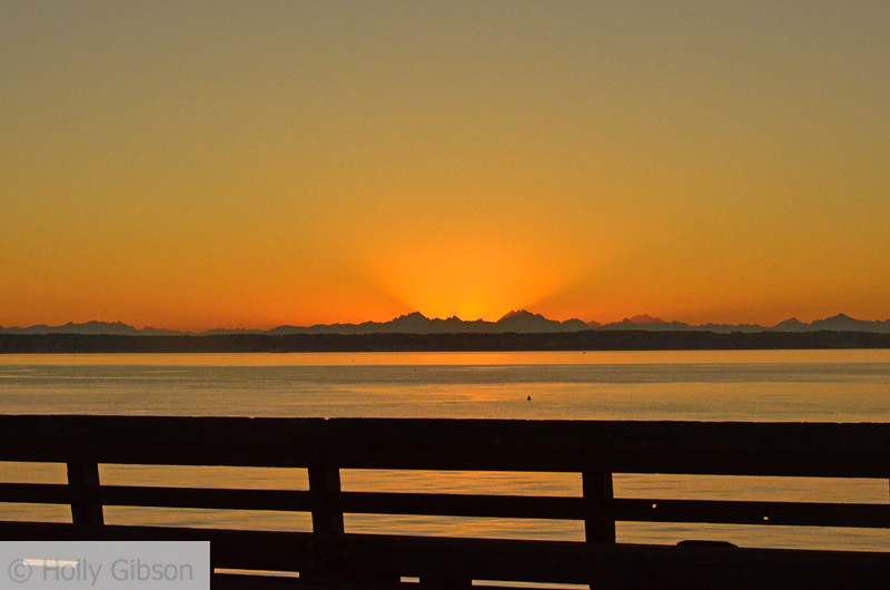 Sunrise over the cascades from pier