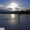 Man paddling on board  across the lake at sunset - 61