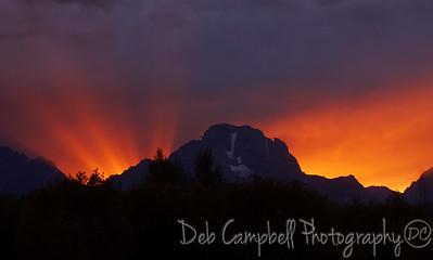 Sun setting behind Mount Moran Grand Teton National Park