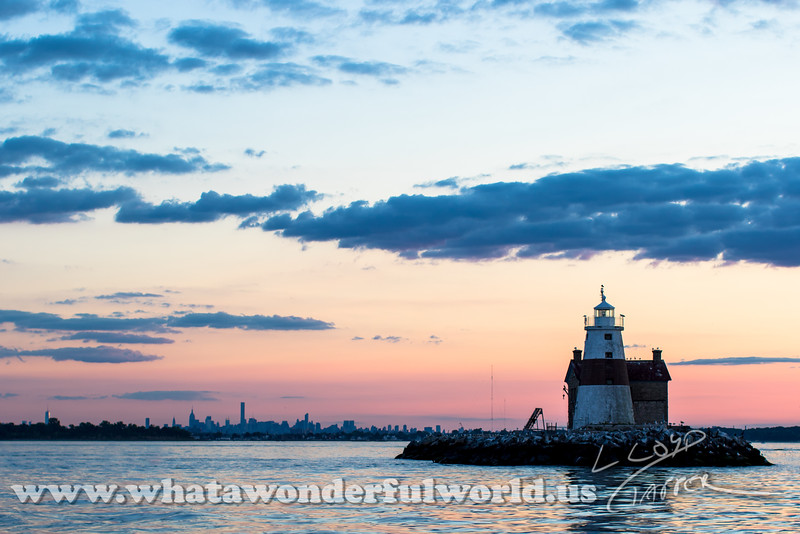 Execution Rocks Lighthouse and NYC at sunset