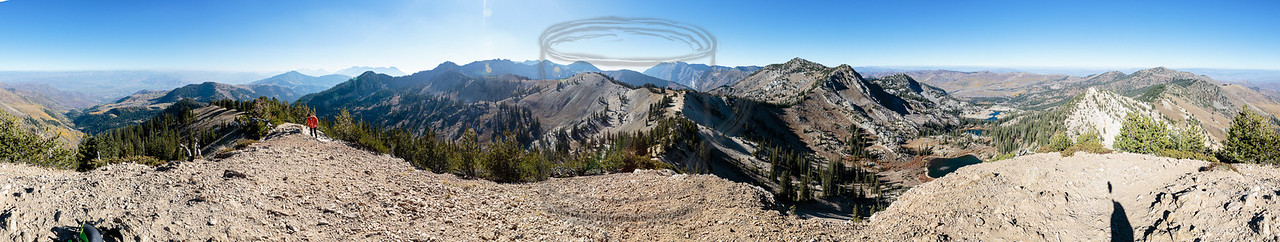 360 degree pano from Sunset Peak, UT, elev 10,648'. Ethan is on the ridge pointing south. The sun is in the west. The lakes point north. The image wraps at the east.