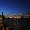 Just after sunset view of the Talmadge Memorial Bridge over the Savannah River you can see the cargo ship coming through!