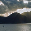 Sailboat heading out at Sunrise off the Commonwealth of Dominica.