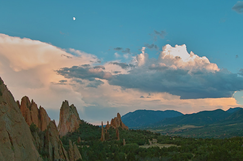 Garden of the Gods dusk with moon and brewing storm. Looking South toward Cheyenne Mountain.