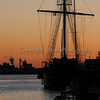 Sunrise on the Savannah River with the Tall Ship Peacemaker in silhouette