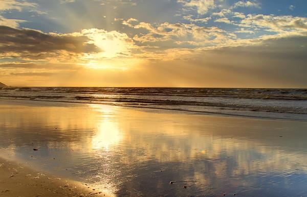 Golden sunset on the beach.  This was taken on Paekakariki beach, New Zealand.