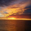 A beautiful sunset off of the bridge heading to Sanibel and Captiva Islands