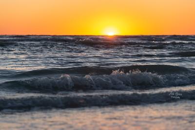 Making waves. 🌊 Watching a sunset. 🌅 Taking photos. 📷 Walking along the shore. 🚶♀️Printing Photos. 🖨