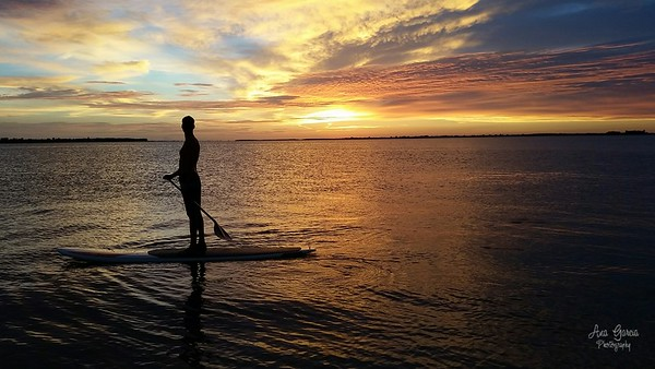 Paddling off into a beautiful sunset
