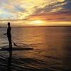 Paddling off into a beautiful sunset