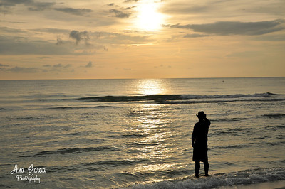 A cowboy watching the sunset in Captiva as it makes him into silhouette