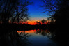 """<span style=""""color:red""""><center><em><h2>""""My 2nd FAVORITE SUNSET of ALL Time""""</h2></em></center></span> This Sunset taken in East Hanover NJ on 3-23-08 along Rt. #280 East is Hands Down my ALL TIME FAVORITE Sunset that I've ever captured on film. I was driving west on Rt. #280 when I looked to the left for some reason and through this little hole in the wood line I saw this scene. I immediately took the off ramp and made a U-Turn to drive to the access road next to the woods so I could find a place to park and run into the woods before it disappeared. If you've sat & watched a sunset before you know how FAST they can leave, not in it's entirety but just those few magical moments every photographer dreams of where the light is just perfect and the conditions just right for an image like this and then PUFF it's gone. It could be a mear 60-90 seconds so you have to grab your gear and take the shot. Unfortunately I didn't have a tripod in my trunk for some reason (I usually have 2 or 3 in there) so I had to make due with bracing myself against a tree and engaging the VR (*Vibration Reduction) function on my lens to help me out with the long shutter speed I would need for this shot to get the colors just right. I clicked off a few frames and then it was gone, just like that! You could actually see the difference in color hue from frame to frame as the light changed it happened that fast.   As I walked back to the car I started to check out what I had on my 962,000 pixel LCD and what I saw was amazing to me. I couldn't wait to get home to see it on my high def. monitor in the studio. So here it was in all it's glory, my 2nd favorite sunset, to me simply MAGICAL !  ~Bill Pador~"""