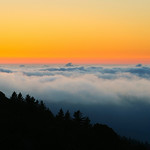 "9/23 ""On Top of the World""   Fog at Sunset at Mt. Tamalpais in the Marin Headlands near San Francisco.  While shooting the harvest moon, I captured the awesome sunset beneath the fog.  Just an awesome sunset to end Summer."