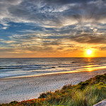 Pajaro Dunes sunset in Summer.  Pajaro Dunes is located near Watsonville, California and has beautiful dunes everywhere.   This is located about 25 north of Monterey.  Houses and condos are right on the beach and the views are spectacular.