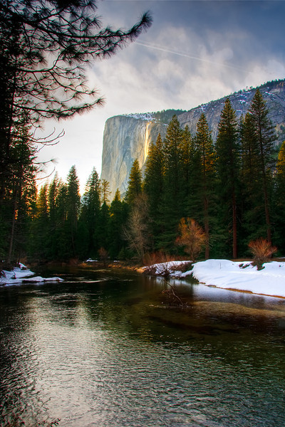 Horsetail falls across the river at Sunset