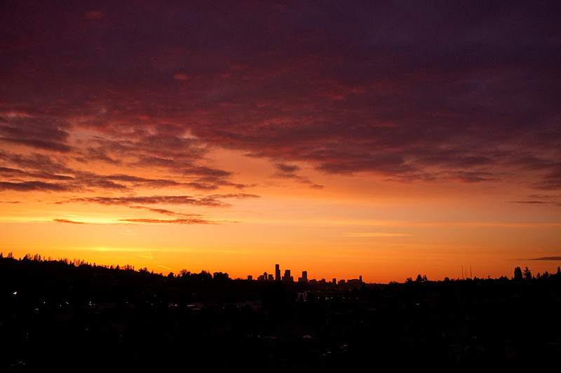 A glorious orange and gold sunset in June, over Seattle's skyline.