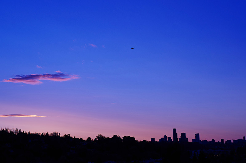 June sunset, with a plane on approach to SeaTac International Airport.