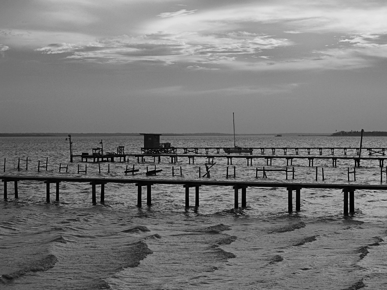 OLYMPUS DIGITAL CAMERA--Sunset on Baffin Bay, looking out from our pier.  The waves looked<br /> very unusual this evening, almost like snow drifts in the picture.