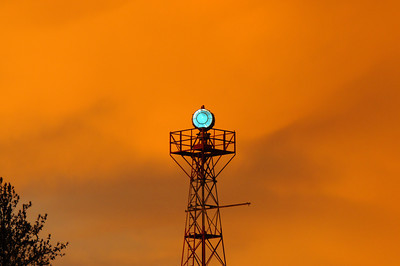 airport beacon with dramatic sky color after storm