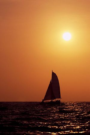 sailboat at sunset, Kona, Hawaii<br /> ( Central Pacific Ocean )<br /> 1