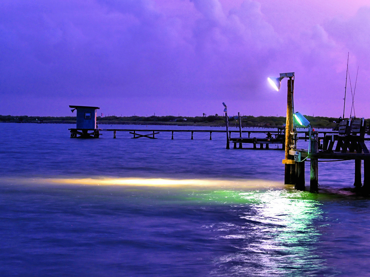 OLYMPUS DIGITAL CAMERA--The lights at the end of the pier are on  at sunset.  The lights stay on<br /> all night to attract baitfish, which in turn attract speckled trout, redfish, and black drum.