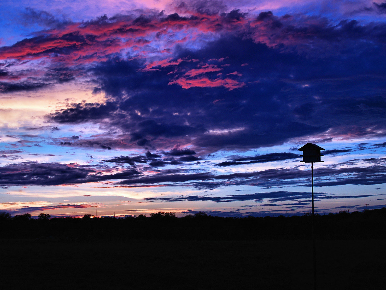OLYMPUS DIGITAL CAMERA--Nice colors in the clouds as the sun goes down.