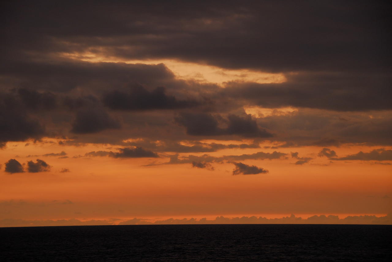 Last rays of light on the horizon seen from Keauhou Point, Big Island, Hawaii