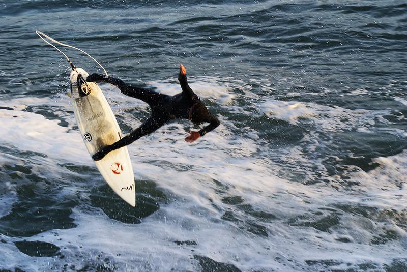 A surfer goes flying through the air at Santa Cruz's Steamer Lane.