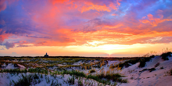 Brilliant sunset view of Currituck Beach Life Saving Station house , now a private residence in Swan Beach. The Life Saving Station, originally built in the 1870's, was once called Whaleshead and also Jones Hill and it was located about a mile north of the Currituck Lighthouse until the mid 1980's when it was moved up to Swan Beach.