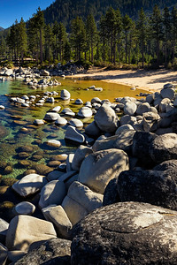 Sand Harbor, Lake Tahoe, Nevada on a sunny day with blue sky and clear water.
